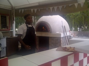 Friendly Yongs working his pizza magic - wish I had a better pic to show off the bright and breeziness of this area.