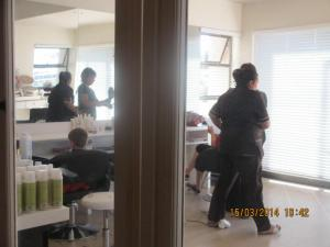 Quick peek at the hair salon in passing.