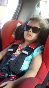 School pickup: Homeward bound, and a little frazzled from the day. But so chilled out with her O-V Optics shades.