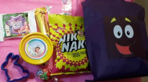 Whats in the bag: Niknaks,Chomp, Home-made play dough in a Dorafied container, cookie cutter, Lollipop, Dora Mcvites biscuits, and (not pictured here) Dorafied smarties