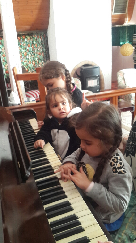 May have misplaced the shot of my girls helping me blow out my candles at the family lunch my mom hosted for me, but still have the shot of them and my god child playing happy bday for me on the piano!