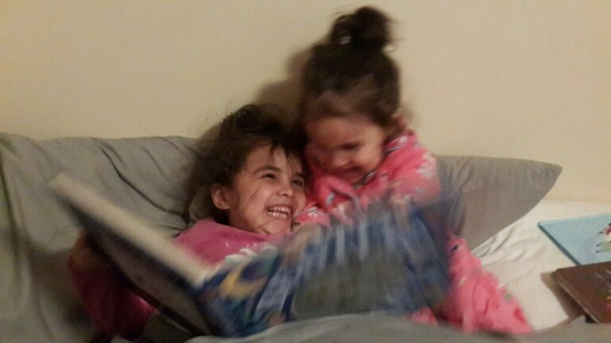 Sister giggles: You were tickling your sister, instead of reading your own book - I hope you never lose this special bond, and that it only grows.