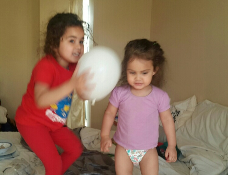 One unmade bed, one nappy clad birthday girl and one half dressed school girl, all make for great balloon shenanigans in the mornings.