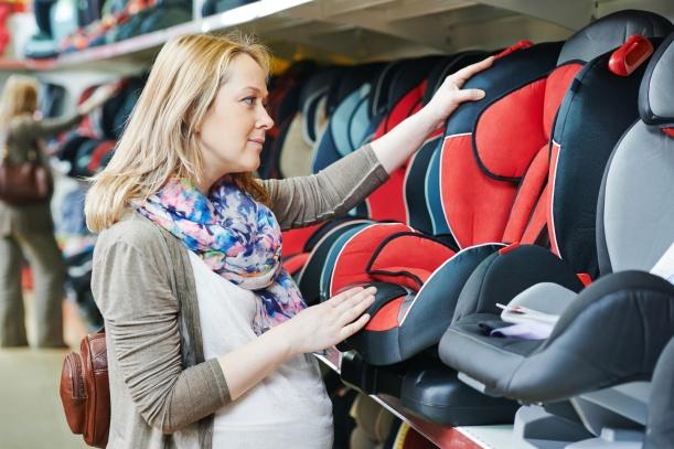 woman choosing child car seat